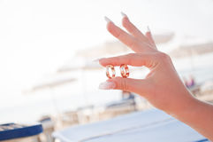 Wedding rings in the hands of women Stock Photos