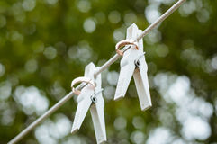 Wedding rings hanging on a string Stock Photography