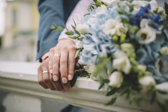 Wedding rings. This happy couple`s wedding day Stock Photo