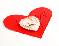 Wedding rings on the heart Stock Photos
