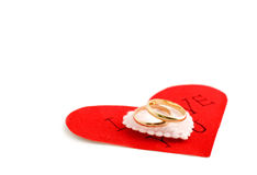 Wedding rings on the heart Royalty Free Stock Image