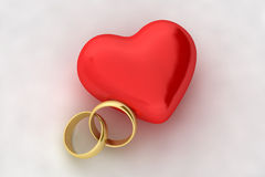 Wedding rings and heart Royalty Free Stock Image