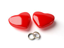 Wedding rings and heart Stock Photos