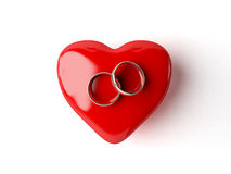 Wedding rings and heart Royalty Free Stock Images