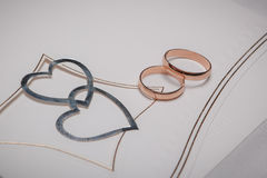 Wedding rings with heart decoration Royalty Free Stock Photos