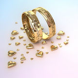 Wedding rings with hearts Royalty Free Stock Photos