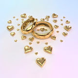 Wedding rings with hearts Royalty Free Stock Images