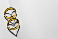 Wedding rings with hearts Stock Photo