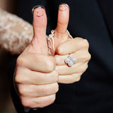 Wedding rings on her fingers painted with the Stock Images
