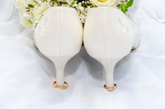 Wedding rings and high heel sandal Royalty Free Stock Photo