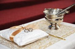 Wedding rings with holy water Royalty Free Stock Image