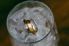 Wedding rings in ice water Royalty Free Stock Image