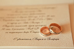 Wedding rings on the invitation Royalty Free Stock Photo