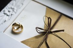 Wedding rings with invitation Royalty Free Stock Image