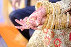 Wedding rings and jewellery at the indian ceremony Stock Photo
