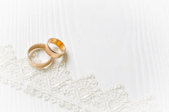 Wedding rings and lace ribbon Stock Image