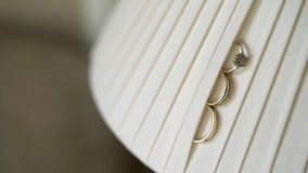 Wedding rings on lamp stock video footage