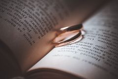 Wedding  rings laying on book Royalty Free Stock Photo