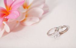 Wedding rings laying on wedding dress Royalty Free Stock Photos