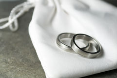 Wedding rings and leather bag Royalty Free Stock Photography