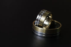 Wedding rings on a leather surface. Wedding rings on a leatherish surface. Indoor shot with ambient light Royalty Free Stock Image
