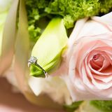 Wedding rings lie on a beautiful bouquet as bridal accessories. Wedding rings lie on a beautiful bouquet as bridal accessories Stock Photos