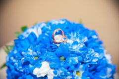Wedding rings lie on a bouquet Stock Images