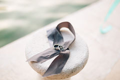 Wedding rings lie on a gray ribbon Royalty Free Stock Images