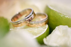 Wedding rings lie on a lemon slice Stock Photo