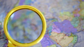 Wedding rings lie on the map.  stock footage