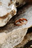 Wedding rings lie on the rock. Wedding day Stock Images