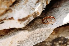 Wedding rings lie on the rock. Wedding day Stock Image