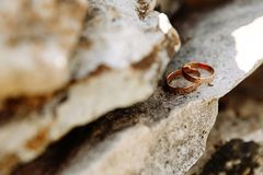 Wedding rings lie on the rock. Wedding day Stock Photography