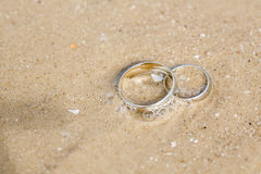 Wedding rings lie on sand. Wedding concept - wedding rings lie on sand Stock Images