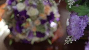 Wedding rings lie on a wedding bouquet. Wedding rings lie on a beautiful wedding bouquet stock video