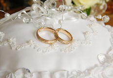 Wedding rings. Lie on the white cushion Royalty Free Stock Photos