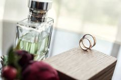 Wedding rings lie on the wooden box,bridal accessories, European Stock Images