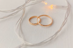 Wedding rings and lights Stock Images