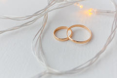 Wedding rings and lights Stock Photos