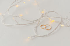 Wedding rings and lights Royalty Free Stock Photos