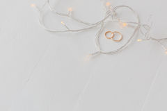 Wedding rings and lights Stock Photography