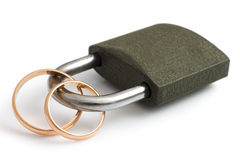 Wedding rings locked with lock  on white background Royalty Free Stock Photo