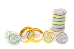 Wedding rings and Loveheart candy sweets Stock Photography