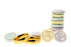 Wedding rings and Loveheart candy sweets Stock Images