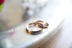 Wedding rings. Lying on the edge of an iron plate Stock Photo