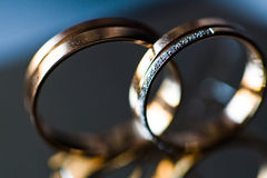 Wedding rings macro. Closeup of two gold wedding rings Royalty Free Stock Photos