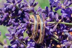 Wedding rings macro on lavender Royalty Free Stock Photo