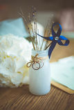 Wedding rings on a mat bottle on background wooden table. Weddings ring and other objects Royalty Free Stock Photography
