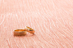 Wedding rings on the material Stock Image