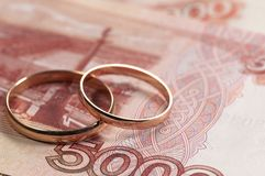 Wedding rings on money Royalty Free Stock Photo